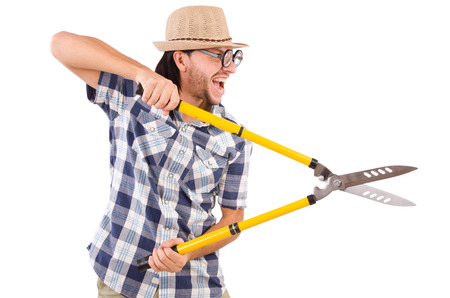 Funny guy with garden shears on white photo