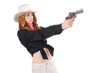 Young cowgirl with handgun isolated on white photo