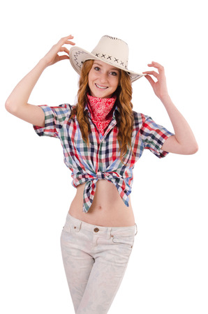 Joyful redhead cowgirl isolated on white photo