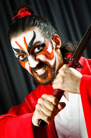 Man with sword and face mask Stock Photo - 27261639
