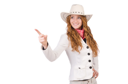 Young   cowgirl pressing virtual buttons  isolated on white photo