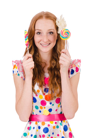 Pretty girl with lollypops isolated on white photo