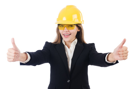 Pretty businesswoman with hard hat and in protective eyeglasses isolated on white photo