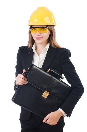Pretty businesswoman with hard hat and portfolio  isolated on white photo