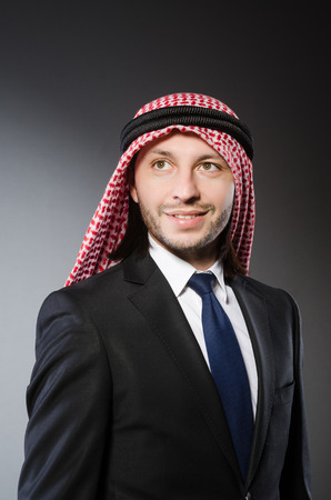 kameez: Arab businessman againt grey background Stock Photo
