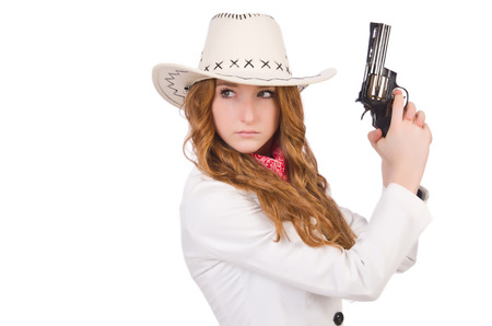 Young   cowgirl with gun  isolated on white photo