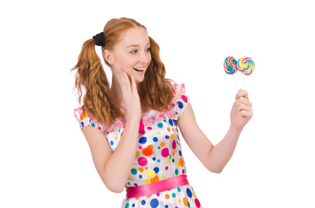 Redhead young girl with lolipops isolated on white photo
