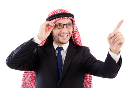 Arab man in specs pressing virtual buttons isolated on white  photo
