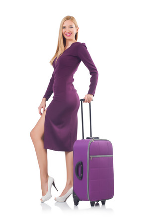 Blonde preparing for vacation with suitcase isolated on white photo
