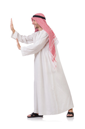 kameez: Arab man pushing away  virtual obstacle  isolated on white