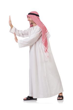 qameez: Arab man pushing away  virtual obstacle  isolated on white