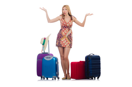confused woman: Woman preparing for vacation with suitcase isolated  on white