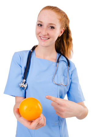 Pretty doctor  in blue uniform  with stetothcope and orange  isolated on white photo