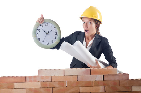 Woman construction worker with clock on white photo