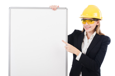 Young builder woman  with  blank board isolated on white photo