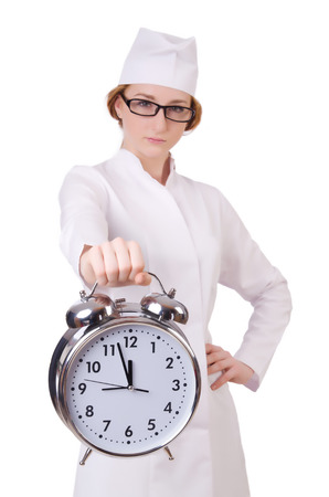 Attractive woman doctor with big clock  isolated on white photo