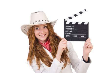 Young   cowgirl  with movie board isolated on white photo