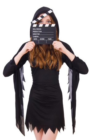 Cute witch with movie board isolated on white photo
