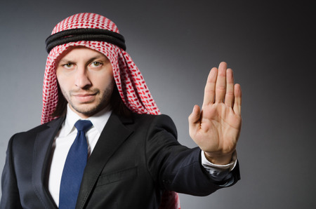 thoub: Arab businessman againt grey background Stock Photo