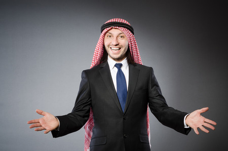 kameez: Arab businessman againt grey background Stock Photo