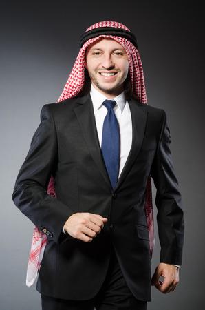 qameez: Arab businessman againt grey background Stock Photo