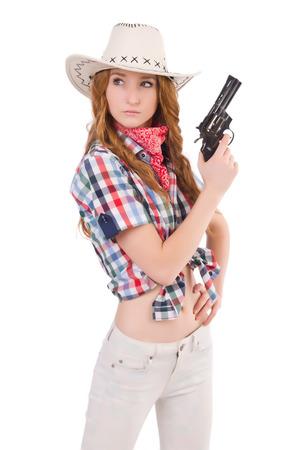 mujer con arma: Redhead vaquera apunta con el arma aislado en blanco