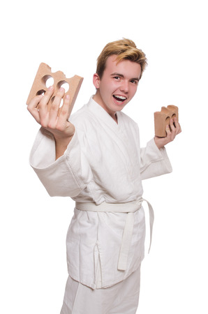 Funny karate man breaking bricks isolated on white photo