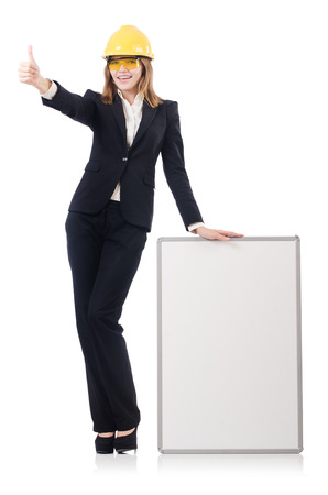 Pretty businesswoman with hard hat and  blank board  isolated on white photo