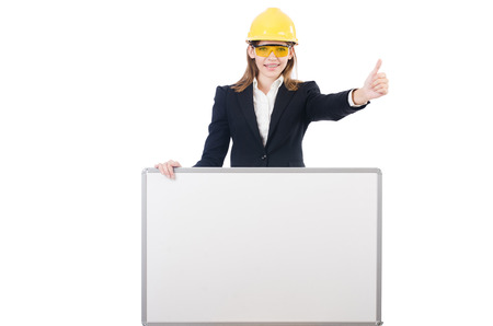 Young businesswoman with hard hatand  blank board isolated on white photo