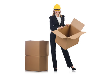 Woman builder with boxes isolated on white photo