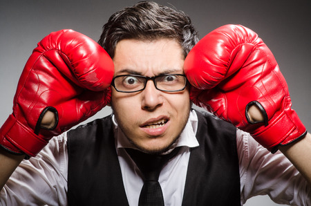 Funny boxer businessman in sport concept photo