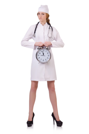 Attractive woman doctor  with stetothcope and big clock  isolated on white photo