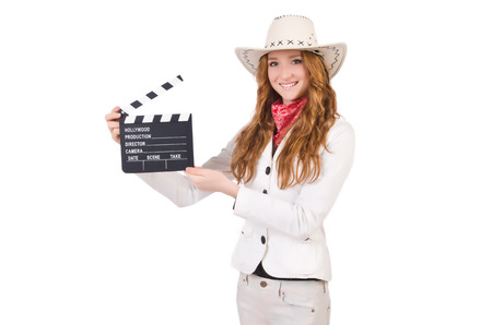 Young  smiling  cowgir with movie board l isolated on white photo