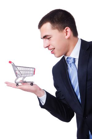 Businessman with shopping cart on white photo