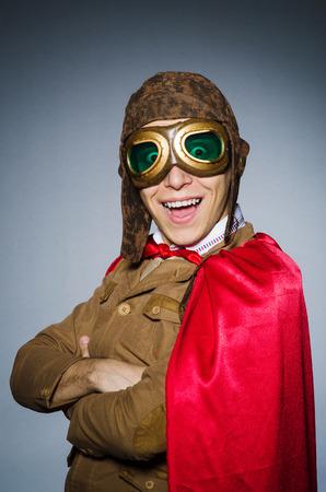 adventure aeronautical: Funny pilot with goggles and helmet