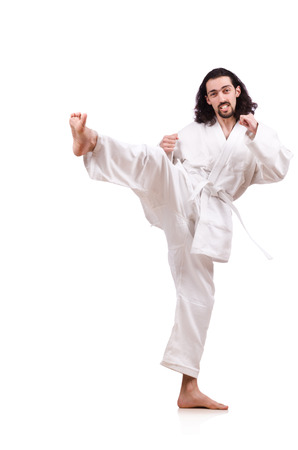 Funny karate fighter isolated on the white photo