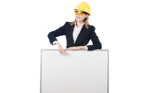 Young businesswoman with hard hat with blank board isolated on white Stock Photo - 27973212