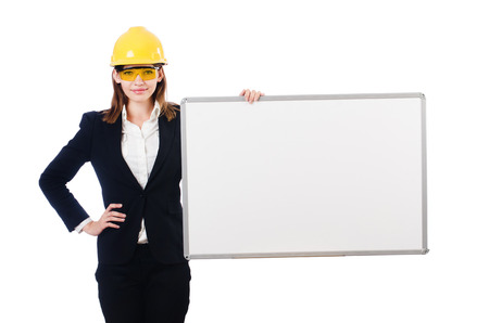 Young builder woman  with  blank board isolated on white Stock Photo - 27973215
