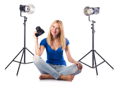 Woman with camera isolated on the white Stock Photo - 27973598