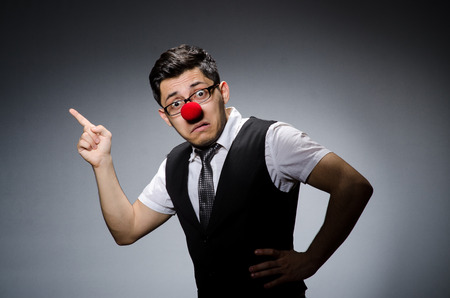 Funny businessman with clown nose Stock Photo - 27973632