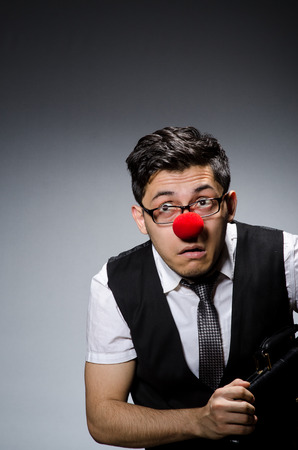Funny businessman with clown nose Stock Photo - 27973636