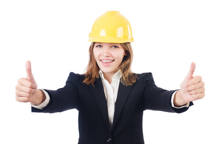 Pretty businesswoman with hard hat thumbing up   isolated on white photo