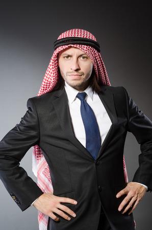 qameez: Arab businesssman against grey background