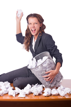 Woman with lots of discarded paper photo