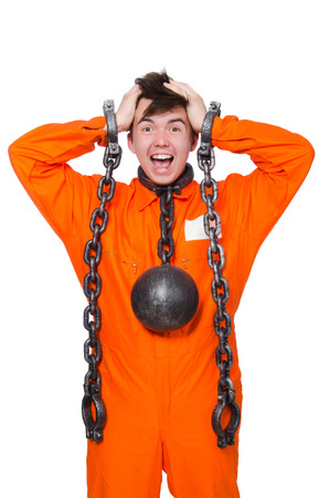 Young inmate with chains isolated on the white Stock Photo - 28367827