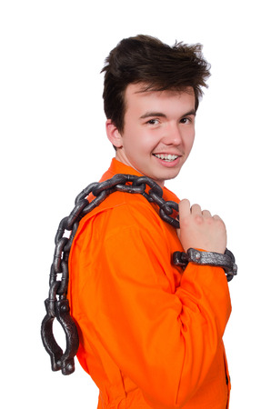 Young inmate with chains isolated on the white Stock Photo - 28368522