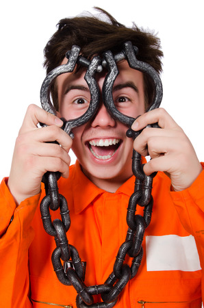 Young inmate with chains isolated on the white Stock Photo - 28368524