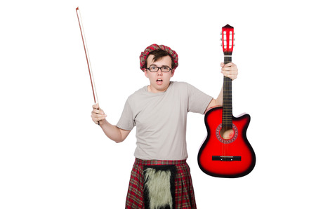 Funny scotsman with musical instrument isolated on white photo