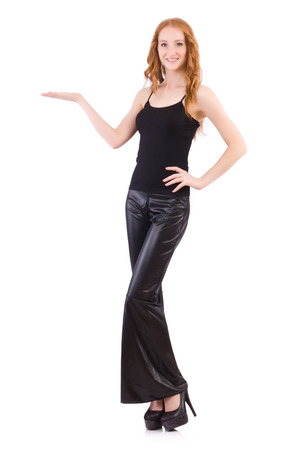 Redhead woman in black bell bottom pants on white Stock Photo