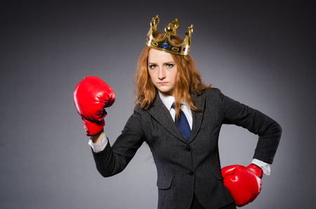 Woman boxer with crown and red gloves photo